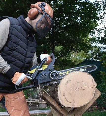 Ryobi Chainsaw Being Used With A Chainsaw Sawhorse